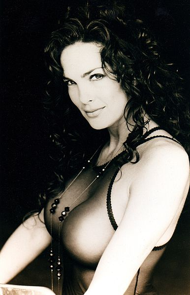 Julie Strain has curly black hair